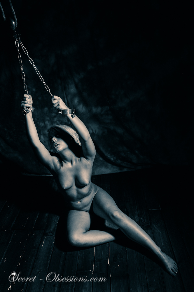 Nude woman in chains