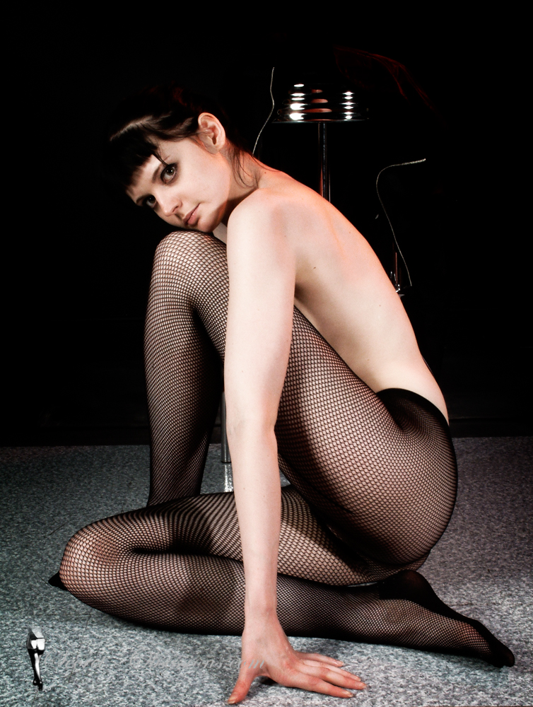 Woman in fishnet tights