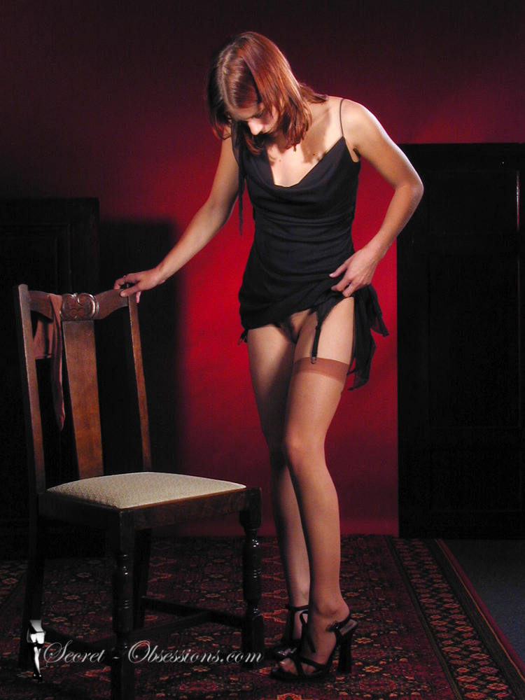 Woman dressing in stockings