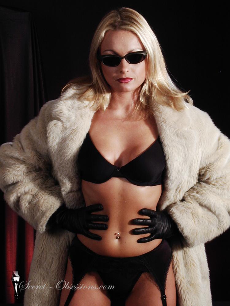 Dominant woman in fur coat